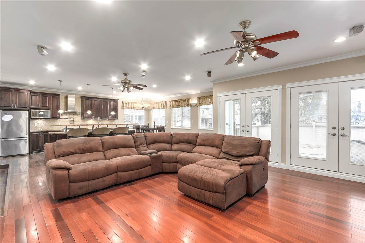 Luxurious custom spacious living 2200 SF on main floor, 1030 SF basement suite. This house has $300,000 in updates from the studs in and out. All new plumbing, electrical, insulation, walls, roof, windows, floors & exteriors, open concept, spacious custom shower & jacuzzi tub in master, large walk in closet.  Granite counters throughout. 4 fireplaces, 2 double vanity bathrooms, 9ft ceilings on the extension, corner alley home. Great southern back yard with extra long attached garage, for all your hobbies and cars. This is an entertaining home with over 320 SF patio and 2 double doors opening on to the patio into the living space. Basement suite was completely updated in the last 2 years. This is a rare find!!!