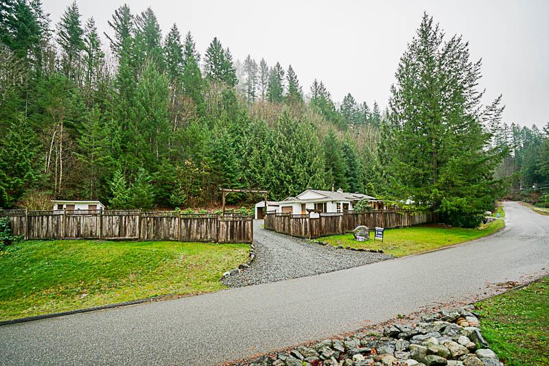 Wow Almost an acre of FREEHOLD land at Cultus lake! This rancher offers just over 1500sqft with beautiful covered patio equip'd with stereo, lighting and hot tub. Privacy fenced large manicured yard with detached shop and cute little well house will make you feel right at home. This home boasts open concept living room/ kitchen, large master suite with huge walk in closet, 2 more good sized bedrooms, and 2 single garages. Great opportunity to enjoy the lake life, walking distance to golf course,2 min drive to entrance bay, Cultus lake marina, and water slides.   By appointment only!