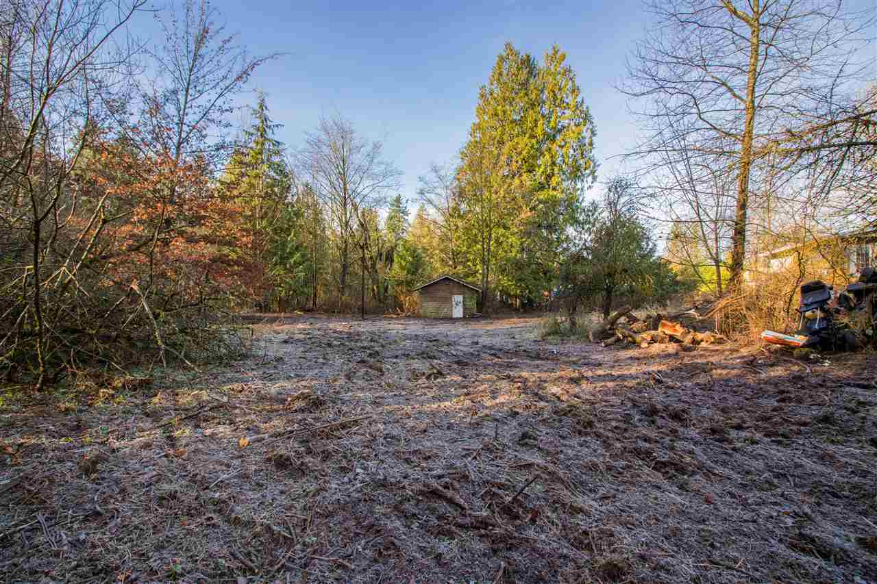 Build your private estate home on this beautiful 5 acre parcel. Southern Exposure with a gentle slope down to a creek at the back. 478 feet of frontage and about 2 acres of useable land North of the creek. Lots of potential here for a large home plus detached shop. Current house could be renovated as a rental or lived in while you design your dream home. Located 5 minutes to HWY 1 access, close to Thunderbird Equestrian Center.