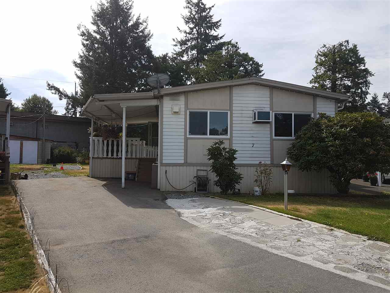 """PARADISE PARK! Well run and maintained adult oriented neighbourhood in West Abbotsford. 55+ age restriction and one small pet is welcome. 3 good sized bedrooms, 2 bathrooms. Nice recent updates include vinyl windows, laminate floors, 2"""" wide vertical blinds, appliances and paint. Detached shop has power and oversized lot (more than 8000 sq ft) could fit a bigger shop or ample parking and gardens. Not your typical """"pad"""". Great area is close to Gardner Park and High Street Mall. Quick and easy freeway access."""