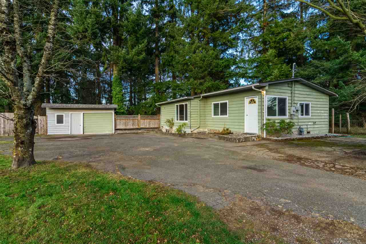 PRIVATE 1.1 acre property on a quiet road in rural Langley, close to Fraser Hwy and 232nd. This mostly level property backs onto a ravine wi/ a creek below. Some massive trees are a nice backdrop for the beautifully updated 2-bdrm rancher w/ unfinished basement, as well as a detached garage/shop. House has many updates including stainless steel fridge, fresh paint, new flooring and brand-new LG laundry machines. This property is ready to move in or build your dream home here! Enjoy tranquil country living w/ RV parking while being centrally located only 7 mins from Langley, Aldergrove and Hwy 1. Close to all levels of schools including Peterson Road Elementary School and D W Poppy Secondary