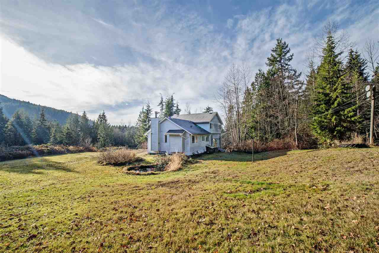 Bright, south-facing, and super private 5 acres. Some of the property is treed but is very usable. The area is an outdoor mecca surrounded by lakes, hiking & biking trails. Only 2 minutes to general store, 20 mins to Mission & Maple Ridge and an hour's drive to the city. 4-level split is well laid out. Main floor features living room & dining room w/wood burning insert. Oak kitchen overlooks lower family room which features a WETT-approved wood burning stove. Large laundry/mud room and a bathroom on the lower level. Up you will find 3 large bedrooms. Ensuite off the master bedroom. The basement is unfinished & features access doors large enough to pull your toys in.