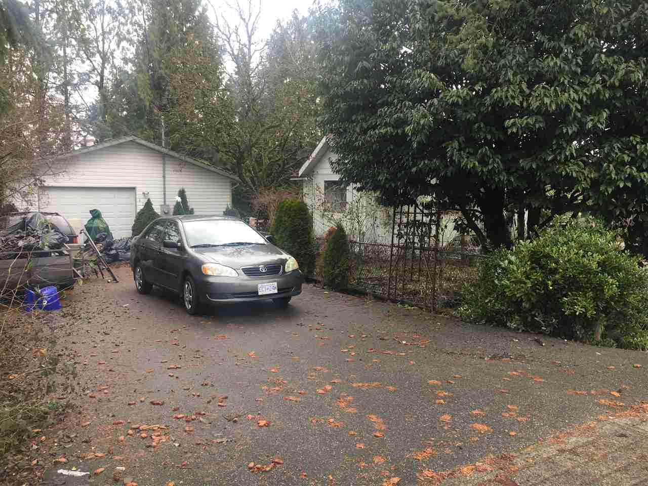 Super liveable 3 bedroom character home and detached garage on a large corner lot. Walking distance to schools shopping and transit. Possibility of future development in this area. Currently rented month to month. Tenant willing to stay and rent back if desired by new owner.