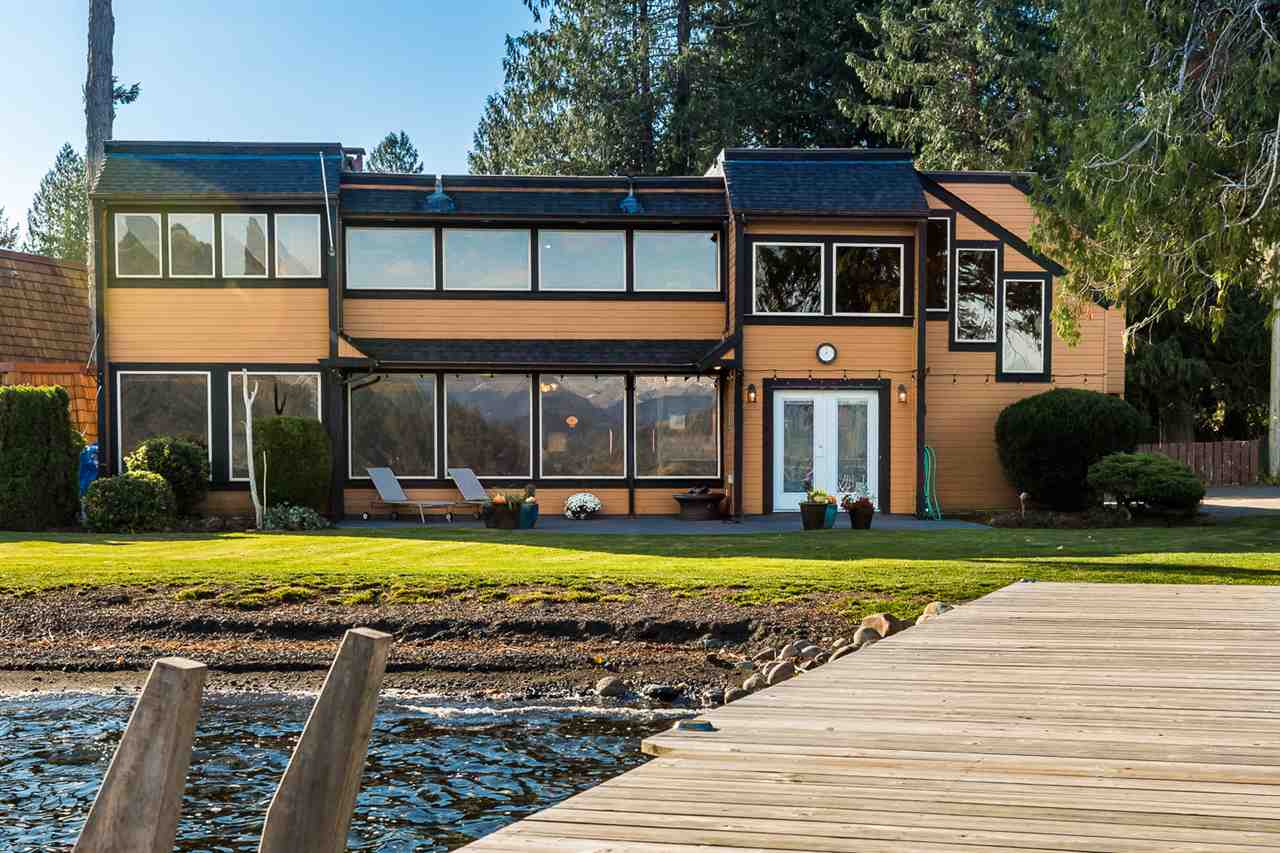 "75 frontage feet of free-hold waterfront at Lindell Beach on Cultus Lake, just a one hour drive from Vancouver. 7500 sq. ft. lot. This house will fit the whole family plus more! Over 4000 sq. ft. with a total of 9 bedrooms, plus den and a bunk house in out-building. Panoramic Lake and Beach views from the numerous massive window all along the main living and upper recreation room. This property has some very special ""time capsule"" 70s features, including ""the Nature Room"" covered in floor to ceiling shag carpet. Original Medieval-fashioned light fixtures. Sauna and semi-private dock. Build memories for generations to come. Ideal for seasonal or full time living. Would make an interesting bed and breakfast or 70's themed film location."