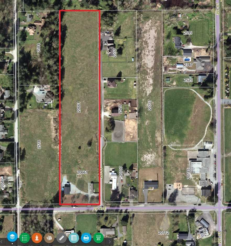 7.5 acres of beautiful level, cleared, gravel based, land, in the recently approved Brookswood Fernridge OCP. Property has two road frontages, city water, 924 square ft registered modular home, and 1200ft2 shop.