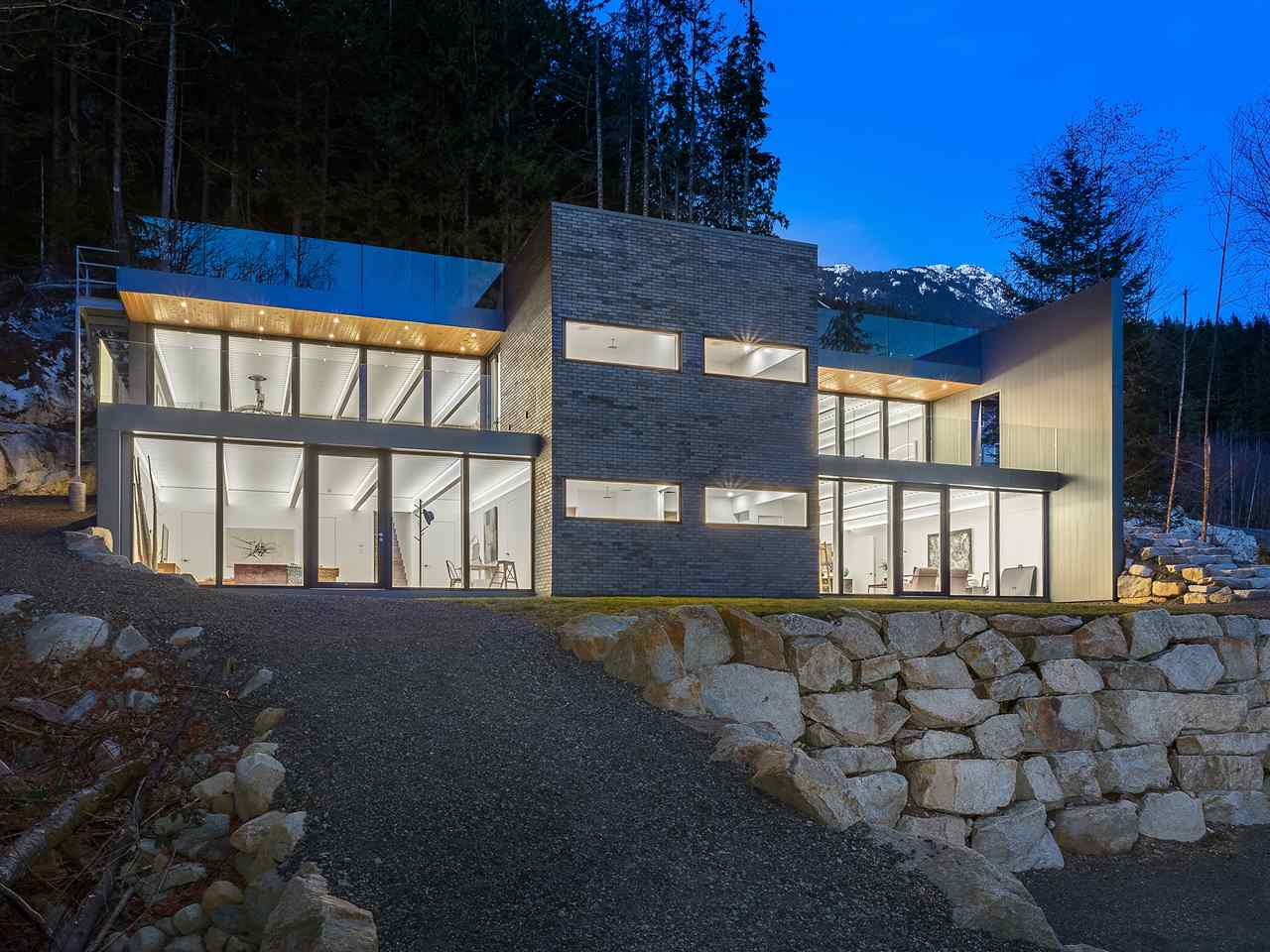This architecturally designed modern home sits amid nature on 1.67 acres, high above the world. From its perch, you are surrounded by the vistas of forest, mountains & Howe Sound. Every room brings an element inside, with views from floor to ceiling windows & custom sliding walls, so the outdoors is always part of your day. Constructed of steel, to seismic levels, the home is open concept, w/ 6 beds, formal living & dining areas & a great room to relax in. Other features include custom kitchen with granite & built-in appliances, oak hardwood staircases, reclaimed Douglas fir wet bar, double showers, & concrete floors with hydronic heat. The home also features a large, almost 1900 sq. ft. roof top patio to escape to, which is wired for hot tub & solar panels & has a helicopter landing pad.