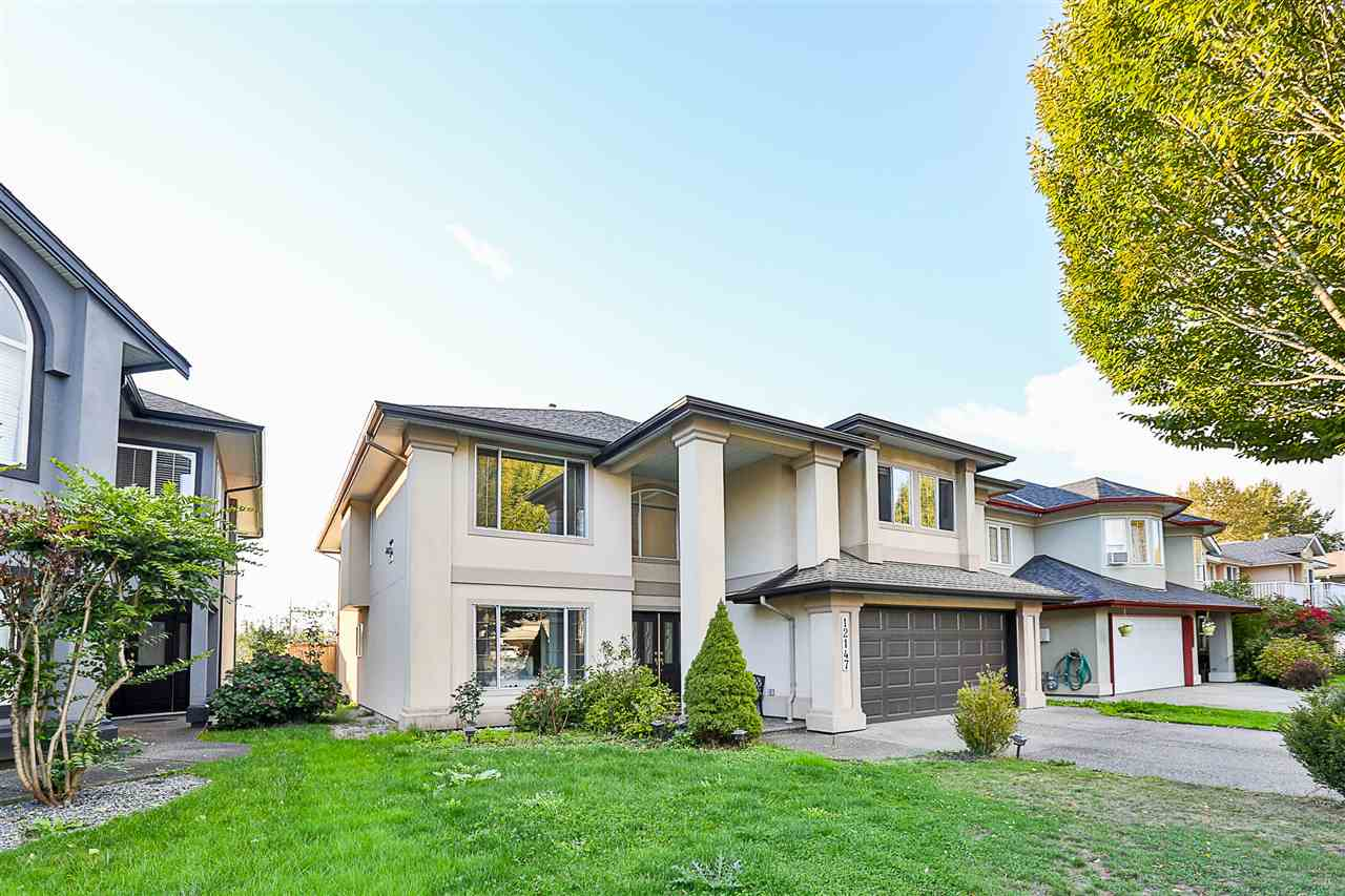 In a quiet,family orientated neighbourhood sits this quality 6bed & 3bath home that backs onto a greenbelt & golf course w/ mountain views.You're greeted by a dramatic,sparkling chandelier in the 17' high foyer.The main level has an open floor plan w/ spacious living room,dining room,3beds,2baths & laundry.Crown moulding throughout w/ 2gas fireplaces & newer laminate flooring.Open & bright kitchen w/ quality appliances & family room w/ french doors leading to huge 35x10 sundeck perfect for entertaining & taking in the views.Large Master bed w/ jacuzzi tub & separate shower ensuite.Below is 3beds w/ 1bath,recroom,43x11 covered patio w/ fenced backyard & separate entry w/ suite potential.Close to shopping,schools,parks & Golden Ears Bridge.Open House Sat. Jan. 20 1-2:30 & Sun. Jan.21 2:30-4.