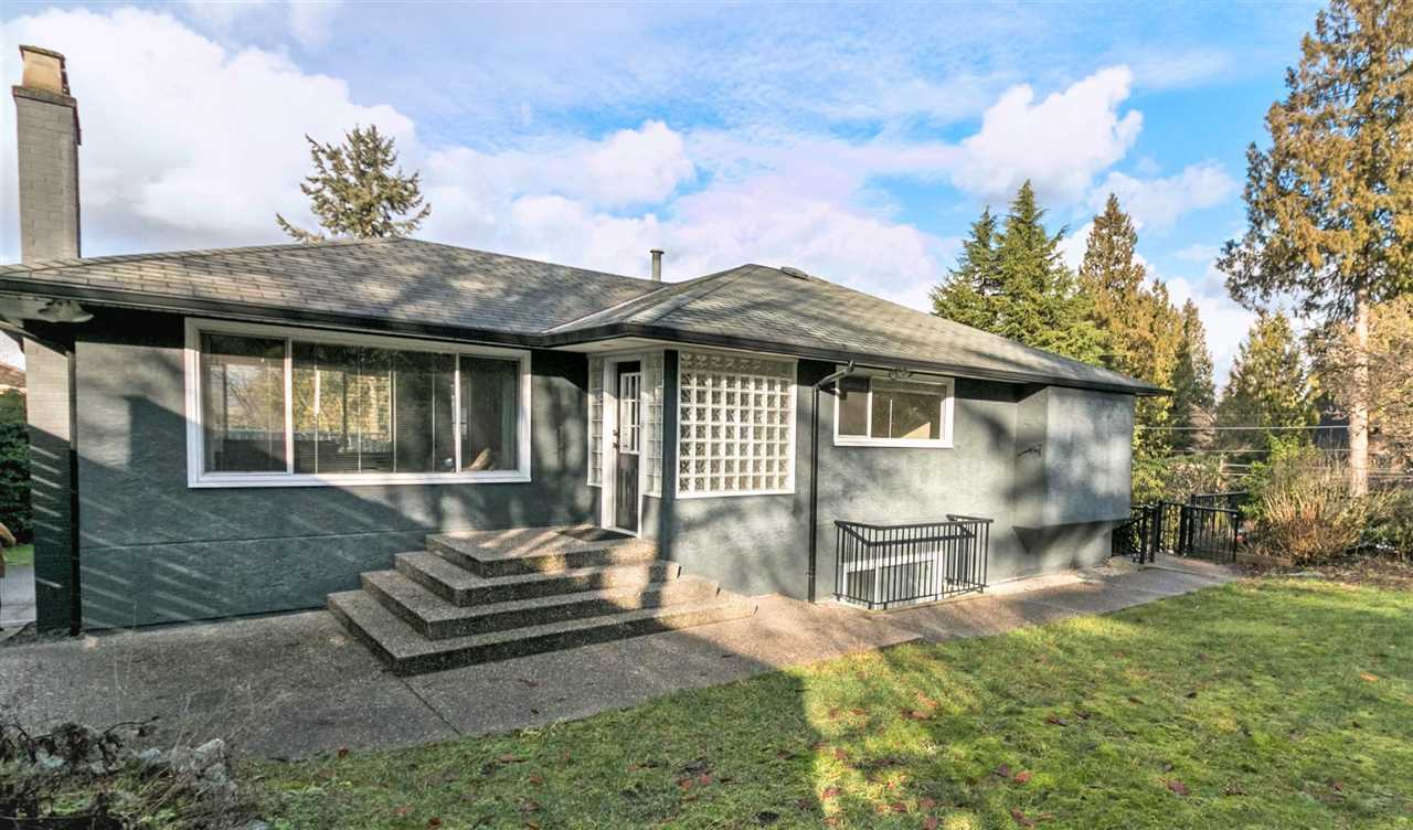 Renovated home situated on a corner lot on the high side of Braemar w/views of the North Shore Mountains! Lower Deer Lake location w/R1 zoning that allows for a 5600 SF house to be built which adds tremendous value to the property! Recent renos: hardwood floors, kitchen cabinets, granite counters, carpets, light fixtures, bathrooms, etc. The large kitchen open to family room & French doors that open to outside deck from the dining room give this home an open feel. Great transition from inside the home to outside as thee are also sliding doors that lead out to the backyard from the recreation room! Double garage & single carport. Short walk to Buckingham Elem and Deer Lake and all its parkland & all the walking trails! Check realtor's website for floor plan!