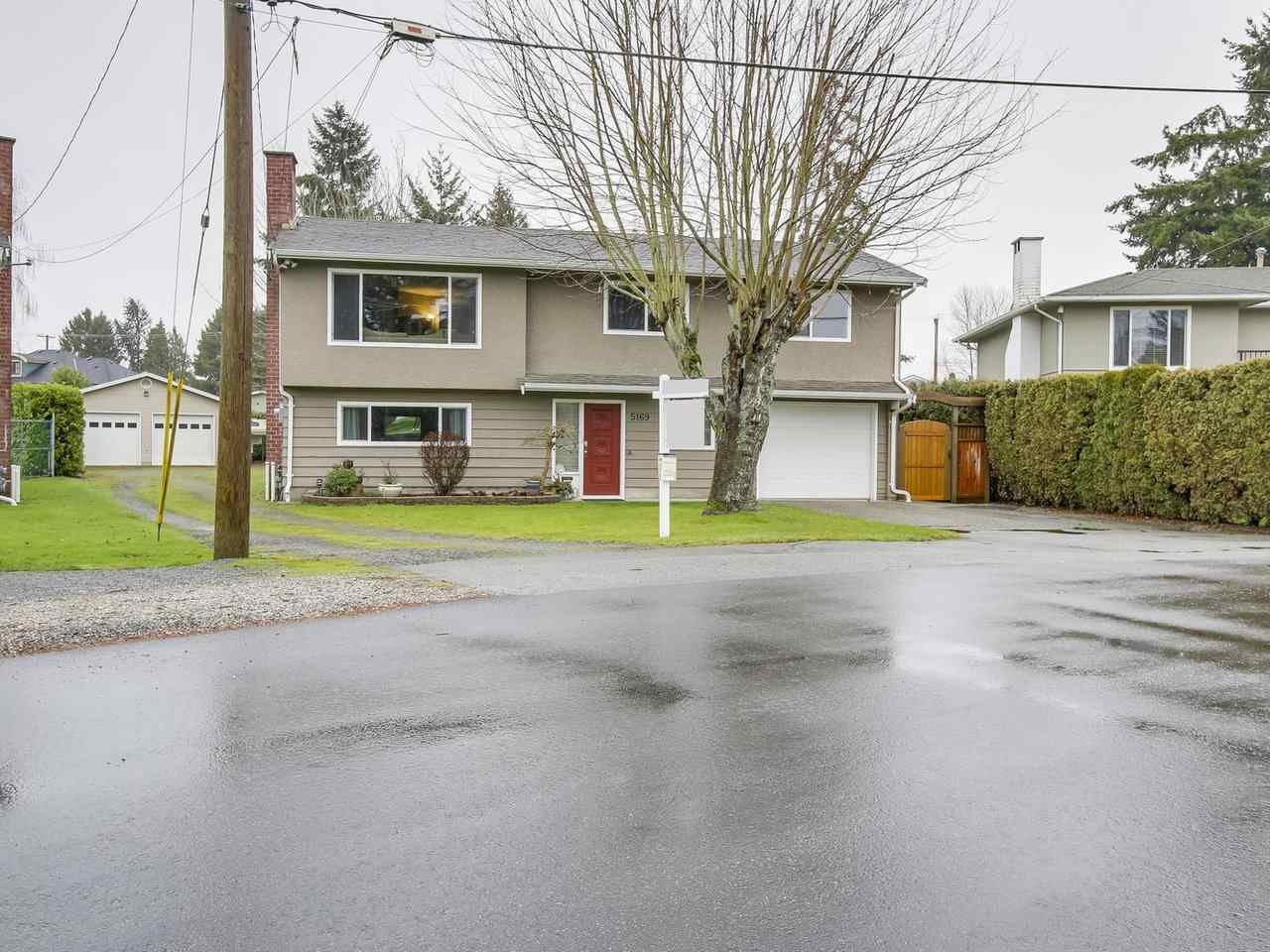 Lots of this size in Ladner are rarer than the most precious gem. 1,500 Sq.ft WORKSHOP - Outstanding opportunity in one of Ladner's most sought after neighborhoods. Updated 2,048 sq.ft, 2 level, 4 bdrm family home is on a HUGE 16,500 sq ft lot. Updated kitchen with s/s appliances, newer bathrooms, large sundeck off kitchen and fully fenced yard. MASSIVE FULLY FINISHED & INSULATED 1,500 sq.ft WORKSHOP built in 2003 with 2 x 6 construction, 100 amp service, heated, vaulted ceilings, skylights - perfect for car enthusiast, mechanic, wood working, dance, gym/art studio, home office or heated storage space or a combination of these things!  Unbeatable location - walking distance to Ladner Village, both secondary & elementary schools, parks, shops, restaurant & amenities. A fabulous property!!!