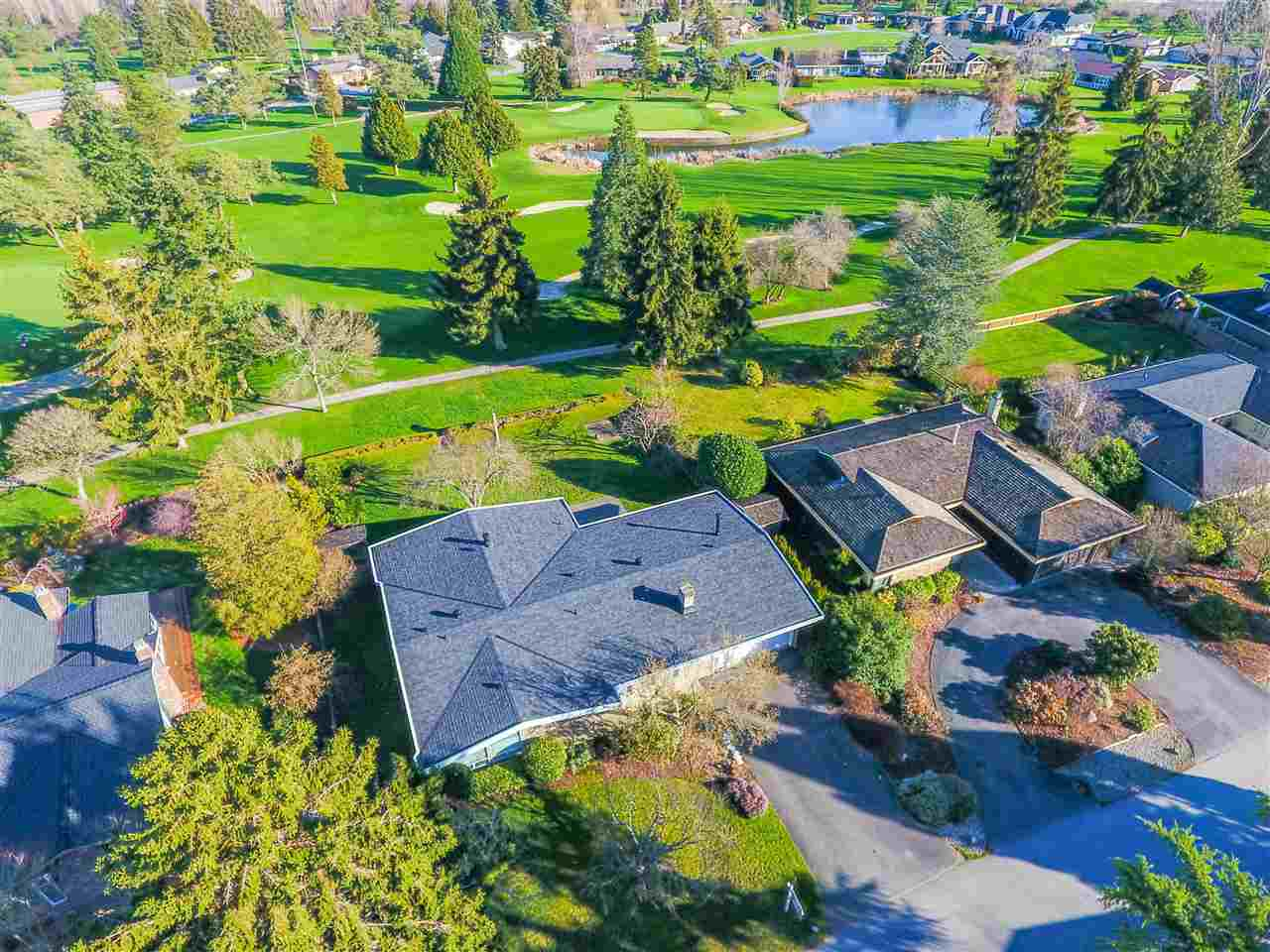 Stunning opportunity to own a large 10,344 sq.ft lot (85' x 122') on one of Tsawwassen's most exclusive and desired streets! Backing on to Tsawwassen's prestigious Beach Grove Golf Course, this prime property offers unbeatable fairway views and features  a well-cared for 3 bedroom, executive rancher offering nearly 2,025 sq.ft. Mid-century inspired architecture with an open concept living room and kitchen make this a great renovation project or option to build over 4,000 sq.ft . Updates include laminate flooring and a new roof in 2015. By private appointment.
