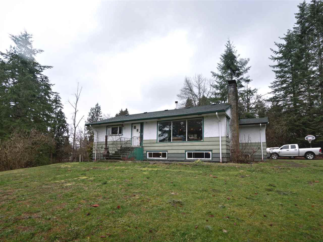 Absolutely gorgeous 1.78 acre property in Silverdale with fabulous Fraser River View. Bordered by beautiful Jaimeson Creek. Older solid 1200 sq.ft. rancher w/full basement and separate entry sits high on the knoll and has total privacy. Shared driveway. Has had some updates. Beautiful American cherry floors, newer kitchen and appliances. Huge parking area. Could have garage rebuilt w/coach house. All meas. approx.