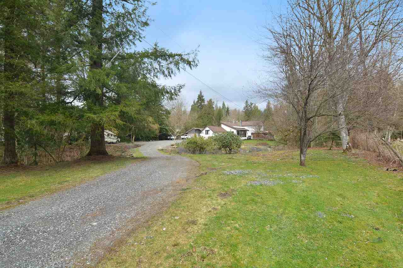 Nice three level split on 2.4 acres!!! Beautiful pond, gentle slope land; great for a hobby farm. Detached approx 400 sqft workshop/garage; cottage/art studio with its own deck overlooking the tranquility and privacy. Minutes to beautiful recreational areas; hiking, boating on the Stave River, walking trails, golf and skiing. Just 10 mins to Maple Ridge OR 12 minutes to the big city of Mission!!!