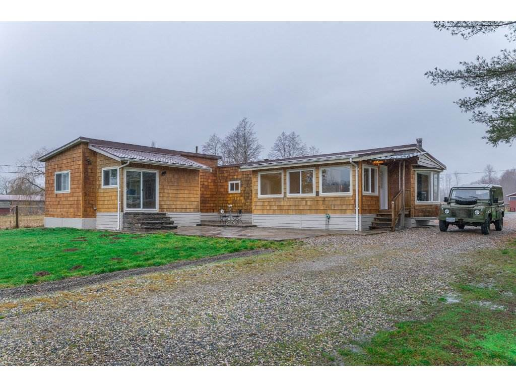 Beautiful 4.58 acre Campbell Valley property located on a no thru street walking distance to the Park. Nicely updated 1835 sqft. rancher/ mobile with addition, 3/4 bedrooms with french doors leading out to a spacious deck overlooking the property. 6 stall barn with tack room, feed room, washroom and workshop. Footing already in for Olympic size sand riding ring. Second driveway already in for future new building site. Rancher/ mobile could stay once new home is built for immediate family and is located over to one side and front of property. Very private quiet location. Properties like this are hard to come by! Please call today for your private showing. Open house Sunday Feb. 4, 1:00 - 3:00.