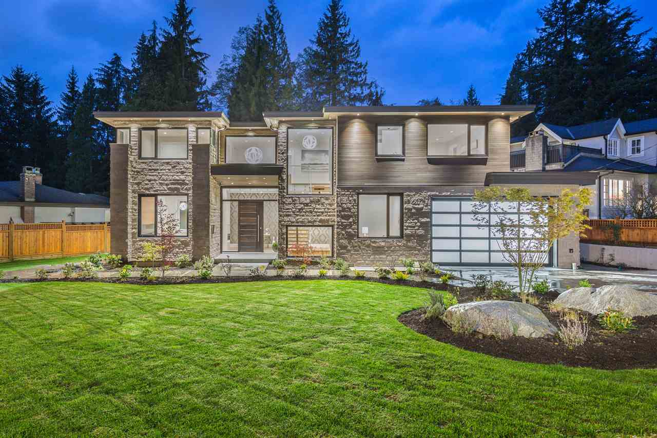 ASSESSED OVER $3,800,000, and NO GST on price! A simply stunning residence in the heart of Edgemont Village. Over 5,000 sq.ft of incredibly elegant living space built to the highest standard, featuring the very best in materials, design & craftsmanship. The quality & detail of this home are equaled by few, if any in the area. Functional, family layout accented by wide plank white oak floors, 12 foot coffered ceilings, floating staircase and a beautiful  onyx stone wine display. Massive gourmet kitchen featuring top of the line appliances, custom cabinetry and quartz throughout. Open plan living room all leading through massive custom doors to deck & backyard. 2 bedroom legal suite downstairs with separate entry. A short walk to Edgemont Village and Cleveland & Handsworth catchments.