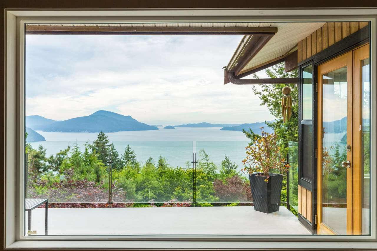 Stunning views of Howe Sound from this gorgeous Lions Bay home. Exceptionally renovated throughout,the main floor is an open concept design and includes granite and top end appliances in the kitchen,leading to a large dining/eating area with a gorgeous sunroom.Living room features a wood burning fireplace guaranteeing warm cozy nights by the fire in the cooler seasons.The master bedroom includes a stylish en suite with French doors opening up to it?s own deck area facing the ocean,truly breath taking!Driveway is flat and easily parks 2 vehicles. Gorgeous back yard ringed by lush flora perfect for family play and privacy.The large downstairs suite is immaculate with its own wood burning fireplace, 2 bedrooms and significant mortgage helper revenue with a long term excellent tenant!Lions Bay is a fantastic community with three beaches, 30 minutes from DT Vancouver,1 hour from world famous Whistler Mountain.This property is very well priced!