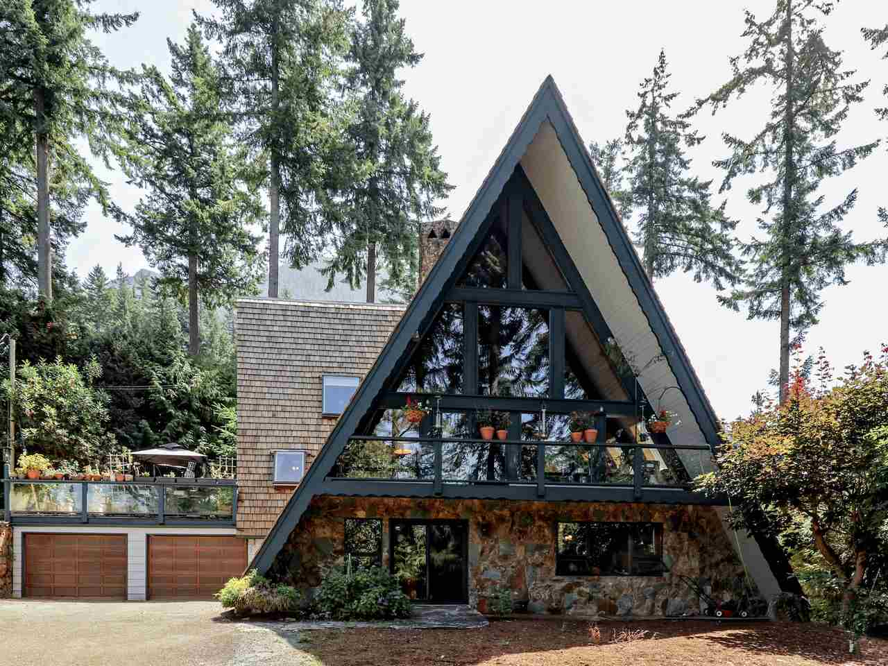 Iconic, quality built & updated A-frame on a park-like 1/2 acre view lot. Featuring 4,800 sq/ft on three levels with 4 bdrms, 3 baths, and oozing the idyllic West Coast architecture that embodied Lions Bay since its inception. This 2 owner home was proudly constructed by the original owner/builder w/ massive hand-hewn wood beams, high vaulted ceilings, & a soaring custom stone fp. The current owner has lovingly updated the house while maintaining the original charm. Features of the renovations incl a new kitchen (w/ Thermador appliances), new bathrooms, new hardwood and tile floors, new propane furnace, new roof and skylights, & new 200 amp service. Situated on a private 25,000 sq/ft lot with ocean & island views, and with rarely available level yard great for families or pets.