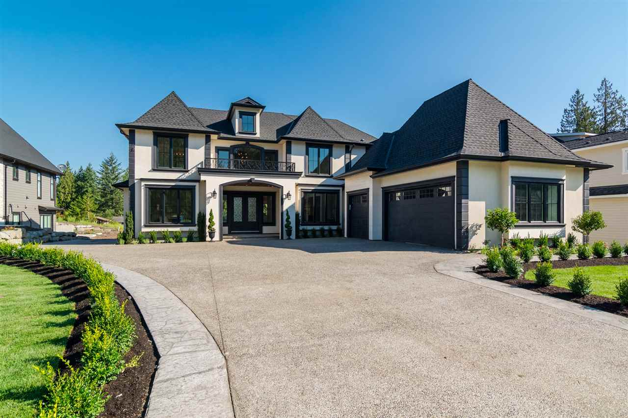 OPEN HOUSE SAT FEB 17 - 12:30 - 2:30pm Absolutely stunning 6869 sq ft two story +bsmt on a 1 acre GD lot in desirable Topham Estates. This home features a grand entrance opening up to a 20' high coffered ceiling in the foyer and family room. 3 Deluxe kitchens, outstanding cabinatry with Meile Appliances, Nano doors open to oversized covered deck with views of Golden Ears and Gas F/P. Quartz countertops. Master bdrm with vaulted cielings, wi/closet and spa enspired ensuite with rain shower and deluxe stand alone tub. Basement is an entertainers dream with full bar, media room,gym and 2 bdrm suite. 3 blocks to Redwoods Golf Course. Please see full stunning pics and v/tours.