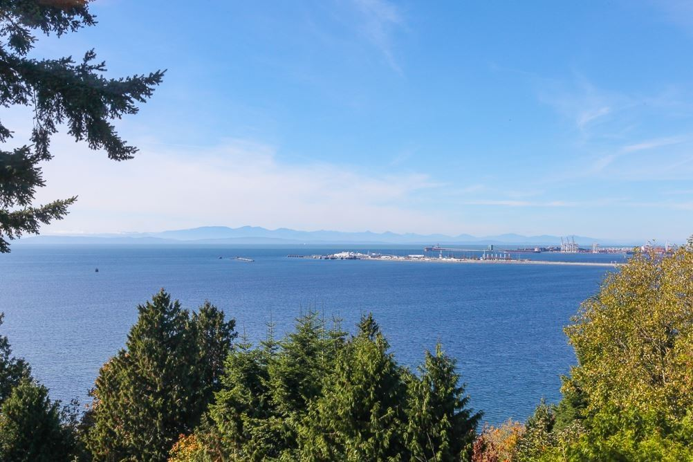 Fantastic 1/4 acre ocean bluff flat lot with gorgeous panoramic views located only steps to Fred Gingell Park for beach access on prestigious English Bluff Road in sunny Tsawwassen within easy stroll to elementary school and Tennis courts. This wonderful property offers an original-well kept approx. 3,835 sqft solid home with partial basement w/ 9ft ceiling and tons of storage. If you are looking for a long term family home with amazing upside- renovate to your heart's content or design your dream home on this desirable view property offering a carefree lifestyle with sunshine from morning to night -endless romantic sunsets and mature landscaping for your outdoor enjoyment. Don't miss this one- phenomenal location!!