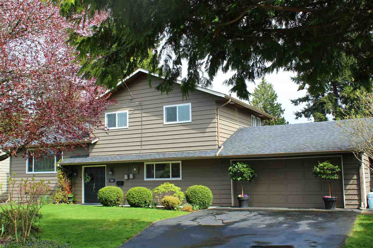 PEBBLE HILL PERFECTION - Totally updated split level sits on a gorgeous 80 X 112 fully fenced property. These long time owners have loved raising their kids so close to sought after Pebble Hill Traditional School and all the adventure of Diefenbaker Park. Located within minutes of beaches and hiking trails in both Boundary Bay and Pt Roberts,Wa. You will agree that this IS the lifestyle you want for your family! Featuring 4 bedrooms and 2 NEW baths, the floor plan offers very comfortable room sizes with light, bright appeal.  Hardwood, newer carpeting, wood burning fireplace, french doors to the 26' x 14' sundeck!  Start dreaming about enjoying the private garden that will soon erupt with spring blooms.  This home is a MUST.