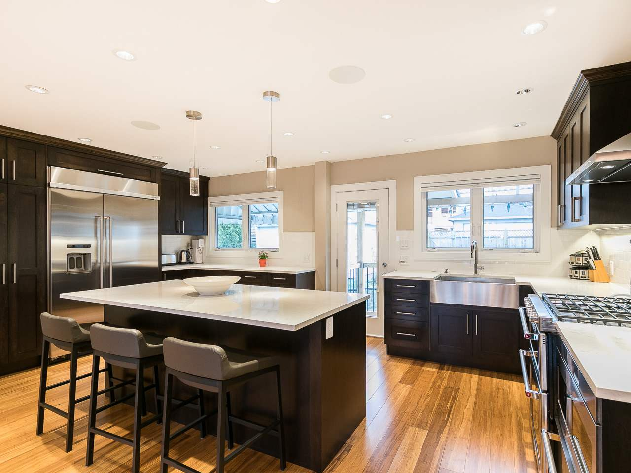 One of the best homes in one of Vancouver?s trendiest areas ? on a 44ft extra wide lot in Fraserhood, through the red door, you?ll be awed setting foot in a renovation truly built for the homeowner. Big windows naturally light the solid bamboo floors & gas fireplace highlighted by the enormous chef?s kitchen w/ 7-ft island incl. wine fridge, 5-burner stove, & custom cabinetry. The large backyard w/ hot tub, gas hookup & planter boxes creates your own private oasis and the furnished suite rented at $2k serves as a great mortgage helper. Other luxury finishes include: Integr. Sonos system, single garage converted into insulated gym & radiant heating. Exceptionally maintained: new plumbing, electrical, hot water tank, rear drainage, roof & windows. This home is not a nice to have - ITS A MUST