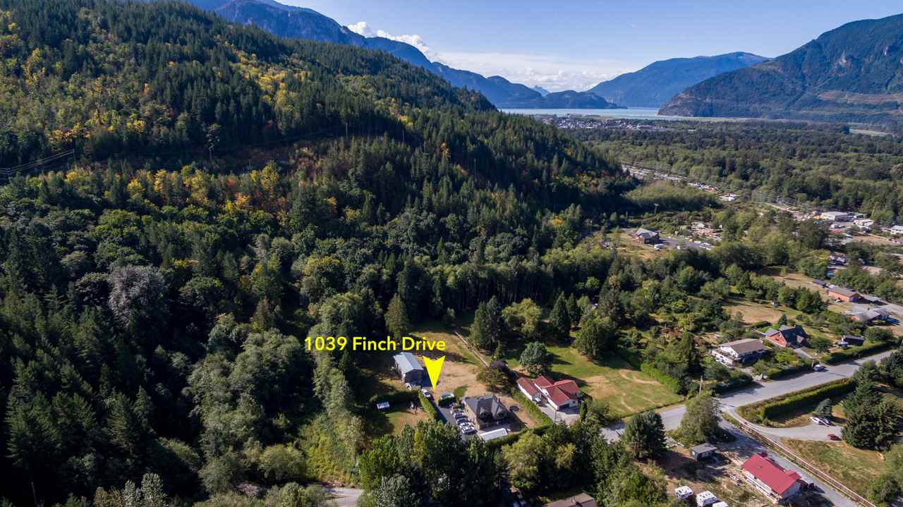 ATTENTION Developers and Investors. This is an incredible and rare opportunity in central Squamish. Over two acres of flat land with a 5 bed beautifully renovated home and large detached workshop. The property is located a mere 900 meters from highway 99, and 1 kilometer from the downtown core. Tucked away at the end of the street, it offers serene privacy without sacrificing convenience. The options with this property are truly limitless; whether you want to live here, use it as a holding property, subdivide, or develop the land, you cannot go wrong. This opportunity will not last long. Call the listing realtor for a private tour today. .