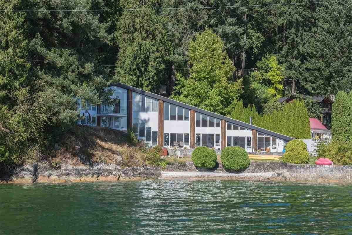 A 27,000 sq.ft. waterfront retreat hidden in an idyllic natural setting with a 200 ft. frontage and private hidden beach.  180 degree sweeping ocean view!  Original house is work of art designed by Dan White while being renovated in the most artistic way at the cost of $1 million.  An inviting lounge/living area with high ceiling, skylights, spiral staircase. The house also features open floor plan perfect for entertaining, custom mill work kitchen, air conditioning and a floor plumbed with heating and cooling system.  Government wharf is just steps away (saving you the worry of building your own!).  Adjacent lot is for sale too - 5600 Indian River Dr. has 14,400 sq.ft. semi-water with ocean view!  Both properties are just 30 minutes from downtown Vancouver.