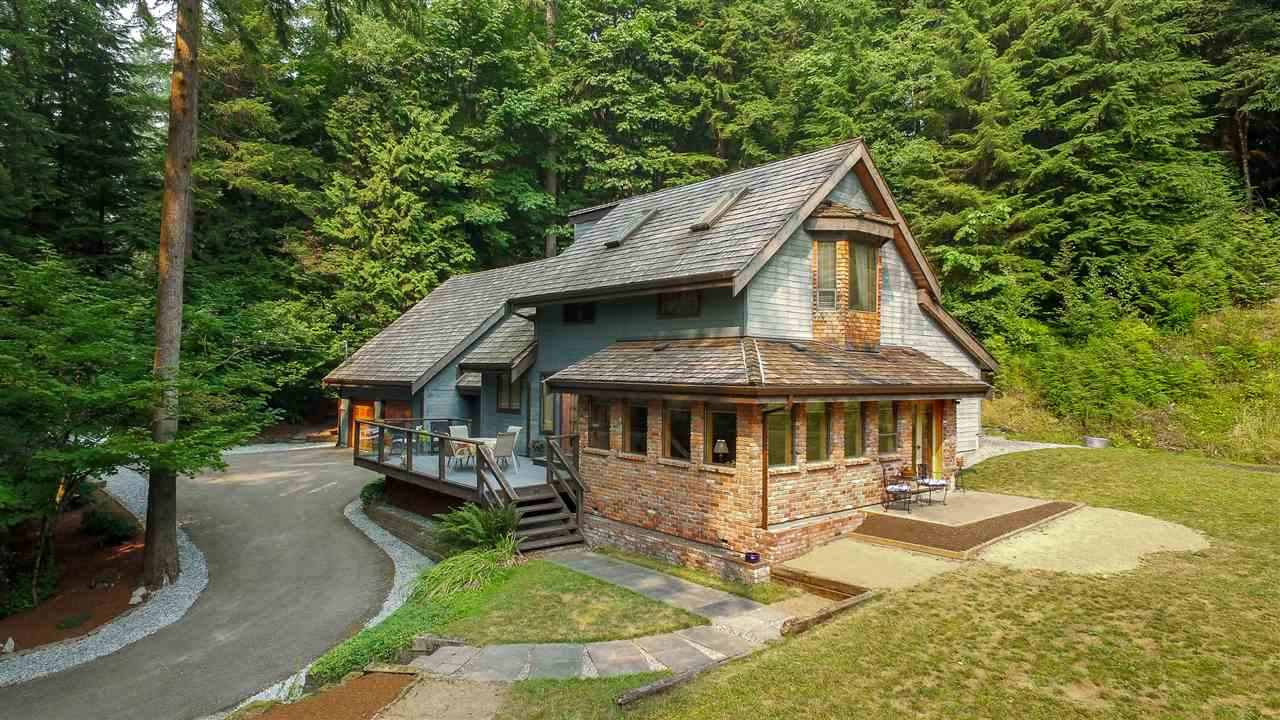 As the crow flies, this traditional custom built two storey 4 bdrm, 3 bth home on a lovely 2.95 acre lot isn?t very far from the city but one look and you realize its 50 years away. As you enter the winding tree canopied paved lane you come upon the character home that seems at one with its natural surroundings. The original owner has added modern touches throughout the years, updated kitchen with gas range and granite counters.  The HW floors, Mexican tile, wood return windows, post and beam ceiling, French doors, skylights make for a great retreat.  A huge games rm, large double garage, level cleared lawn all add to the package. Zoning allows for detached garden suite, possibility to sub-divide. In-law suite potential. Call today for your personal tour!