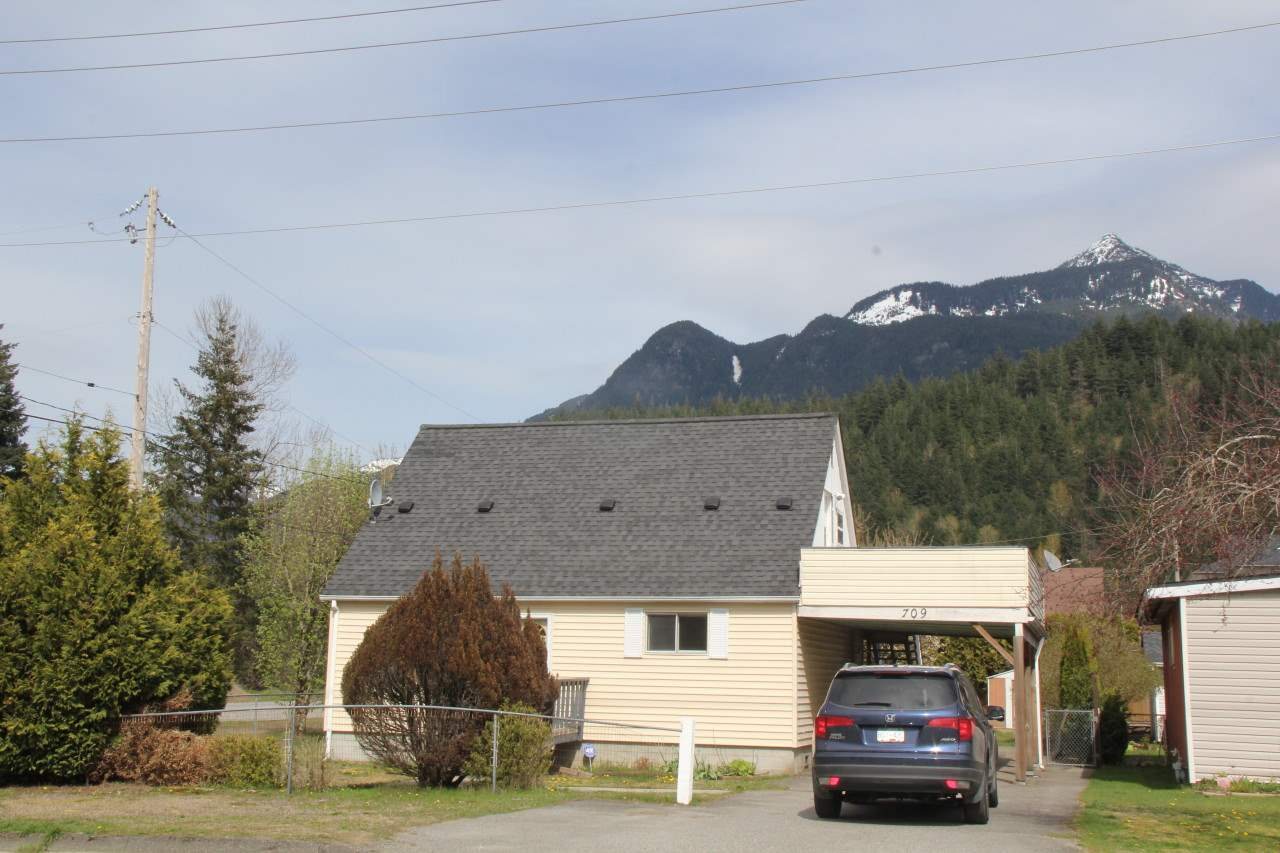 Home with guest suite, terrific corner lot property in town. Walk to everything including golf course and Coquihalla River. 2 bedroom home with self contained, separate entrance guest studio suite above carport. Huge balcony, great mountain views. Fully fenced yard.