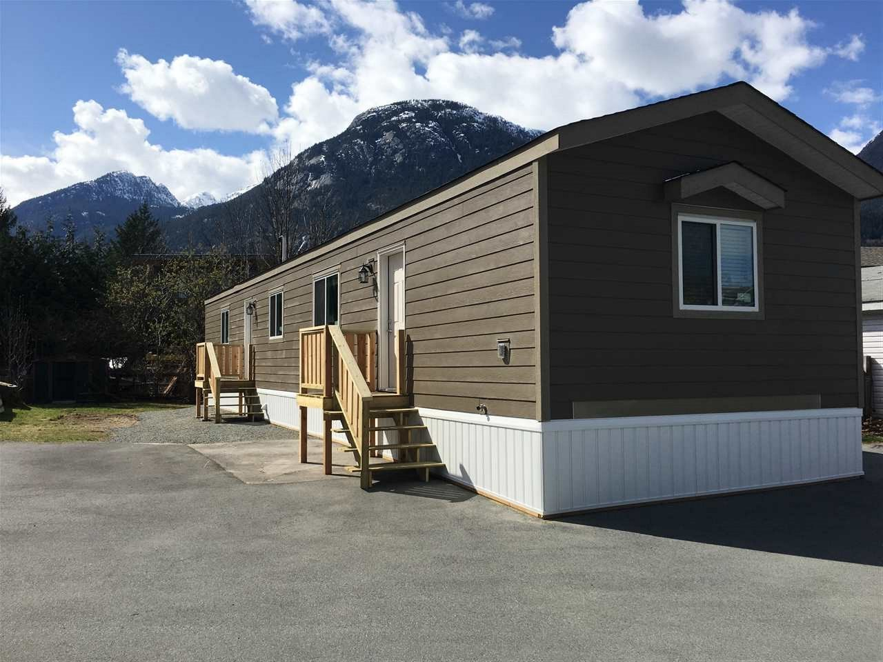A brand new 16 x 66 2018 Moduline Mobile Home on an extra large lot with a mountain view in arguably the best park in Squamish. Full 100 amp service with natural gas, the lowest pad rents and best snow removal are but a few of the deluxe benefits awaiting you. This home has been upgraded to ensure you have luxury living at an entry level price. Vaulted ceilings, upgraded doors, trim, windows, drywall interior, hardi-board exterior, a pantry, a laundry room, a well thought through open floor plan with a large kitchen, large bedrooms, an additional full four piece ensuite and large walk in closet! A perfect start to expand your ideas! Add a wrap around deck, a garage, a foyer style porch, a third bedroom...you have the room and options. A  delight to show! This one will not last long.