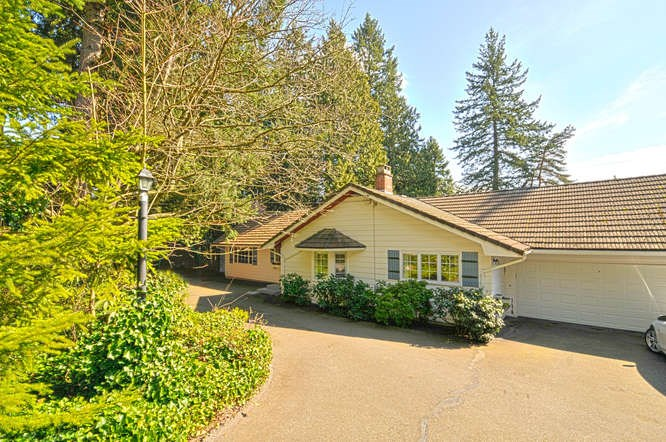 A RARE OFFERING! Gorgeous gently sloping property, 36,154 sqft sunny south facing, corner lot, amazing 234ft frontage.This special home was built in 1961 and has been meticulously cared for by the current owners for 32 years! Many updates including new kitchen, granite, paint, light fixtures, wainscoting, concrete tile roof & stunning original hardwood floors throughout! Master bedroom on the main has oversized windows & overlooks the backyard paradise complete w/tree house! A wonderful family home or great investment!! Rent out while you plan your dream home on this special piece of land. Very private setting minutes away from shopping & amenities. The current home has peek a boo ocean views, a new home would have UNOBSTRUCTED ocean views !