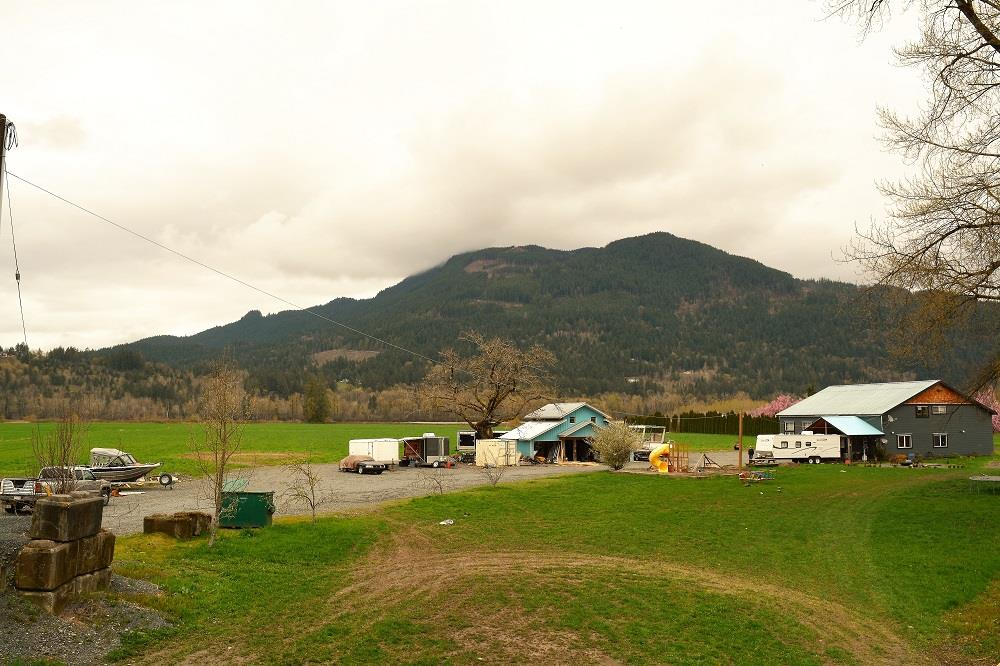 Breathtaking waterfront, mountain & green pasture view...gorgeous 20.46 acres of clear, flat, fertile soil w/green pasture features a charming rancher & a 3000+ sf, 2-story home...Located in a quiet country side yet only 10 minute to downtown Chilliwack. The rancher is completely renovated in & outside, updated with contemporary finishing. The newer 2 story home was a hangar converted into a 4 bedroom/2 bath, tastefully built w/ modern conveniences. Lots of parking for all types of vehicles, RV's. The green pasture can be replaced with crops, trees or just renting out to other farmers for extra income. For the nature lovers, summer fishing on Fraser River at the backyard... snowmobiling in the winter. Please call for more info.