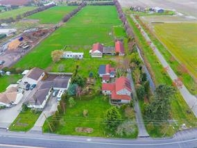Excellent opportunity on Ladner's prestigious Arthur Drive! Rarely available 9.457 acre private estate property strategically located between Ladner & Tsawwassen and only 30 mins to Vancouver. Surrounded by countless luxury estate residences and only minutes into town, this unique offering presents a wonderful chance to build a dream home with farm status or retain and renovate the charming original 3 bedroom home and detached 2 bedroom ranch house. Multiple barns (one with 8 horse stalls), workshop plus a single wide trailer included. Truly serene west facing backyard features beautifully landscaped gardens & fruit trees and offers stunning sunsets every evening. This is a magnificent property in one of the lower mainland's hottest communities. By private appointment.