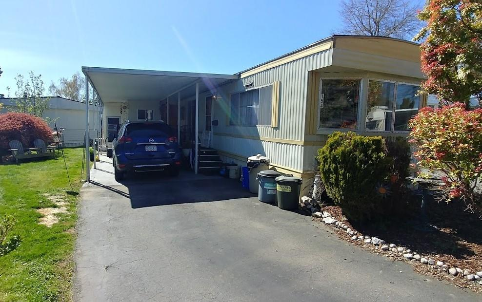 This newly updated 2 beds 776sqft plus addition plus storage area outside, 1 bathroom home is waiting for you. Updates include newer stainless steel appliances, chef's gas stove, updated kitchen, new laminate flooring, 6mth old roof, 2 year old hot water tank, washer/dryer new 2018. Very private living room with gas fireplace to keep you very toasty all winter. Also includes a spectacular outdoor area with a private covered deck area, extra storage room with a work bench and a lovely yard for additional relaxation. Enough parking for 4 cars and a covered carport. Located 5 minutes to the beach and US border Breakaway Bays is a family and pet friendly with a clubhouse and outdoor Pool. Pad rent includes electricity, water, sewer and taxes on the land. Call today to view!New electrical silver seal.