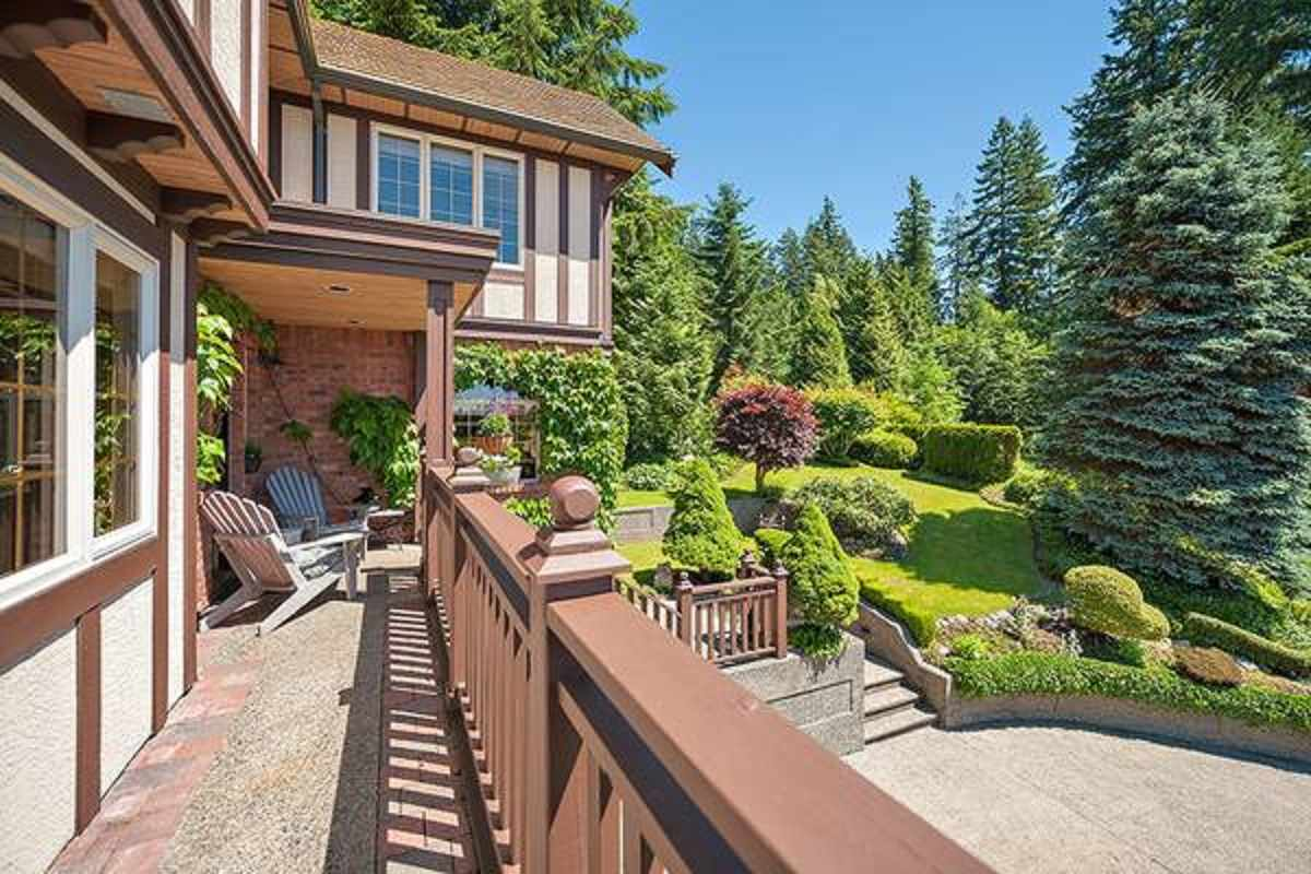 Premier Location! Absolutely gorgeous family home in sought-after Northlands. This architecturally designed 5200 sf tudor home has it all with 5 beds, 3 baths, double garage, plus a 1 bed self-contained in-law suite! First time on the market, this 8668 sf property is located at the top of Orkney Place, a quiet cul-de-sac surrounded by forest, trails and lush professionally landscaped gardens! A grand entrance and formal entertainment sized L/R & D/R adjacent gourmet sized kitch provides ample room for entertaining & large family gatherings! Easy step out access to your private fully fenced west facing gardens, covered patio for year round use, sunken hot tub, and secluded sauna. Call now for your Private Showing.