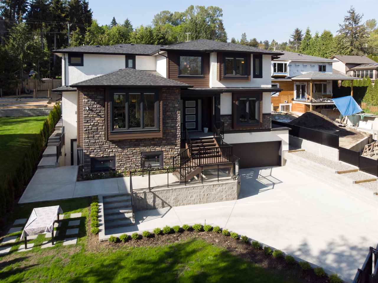 Extraordinary 7 bedroom & 7 bathroom new home situated on a sprawling 12,577 sqft park like lot. Custom built for the owner in 2017, this home offers top quality materials and meticulous attention to detail. Over height ceilings, tilt and turn windows & eclipse doors set this home apart. Main floor: Elegant & functional floor plan offers an open living-dining room with 12' ceilings. Dream kitchen boasts a huge island, top appliances & a large walk-in pantry (roughed in as a wok kitchen). Seamless indoor/outdoor living with the family room opening directly to the covered deck & private landscaped backyard. Office has a closet & window & could be used as a bedroom. Other features include: Triple glazed windows, Italian tile, advanced security system & camera network. Upper floor: Luxurious master suite with ensuite & balcony & 3 other ensuite bedrooms. Lower floor efficiently designed with a legal 2 bedroom suite & 1 bedroom in-law suite with entrance.  Attached 2 car garage with access to a huge storage area.