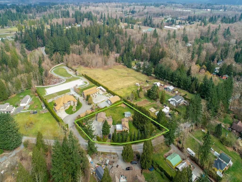 House and Acreage with 3 Workshops (a 26x16' with 100A/240V, a huge 30'x30' shop & an additional 24'x12' shop) conveniently located in Langley! Well kept 3 bedroom house with updated interior paint, lighting and kitchen and a newer roof. The property has a fully landscaped with a fenced yard and perimeter hedges providing lots of privacy. Stunning mountain views. RU-3 zoning allows for a mobile home on the property along with the existing house. Quick and easy access to HWY #1, Golden Ears Way and HWY #13.