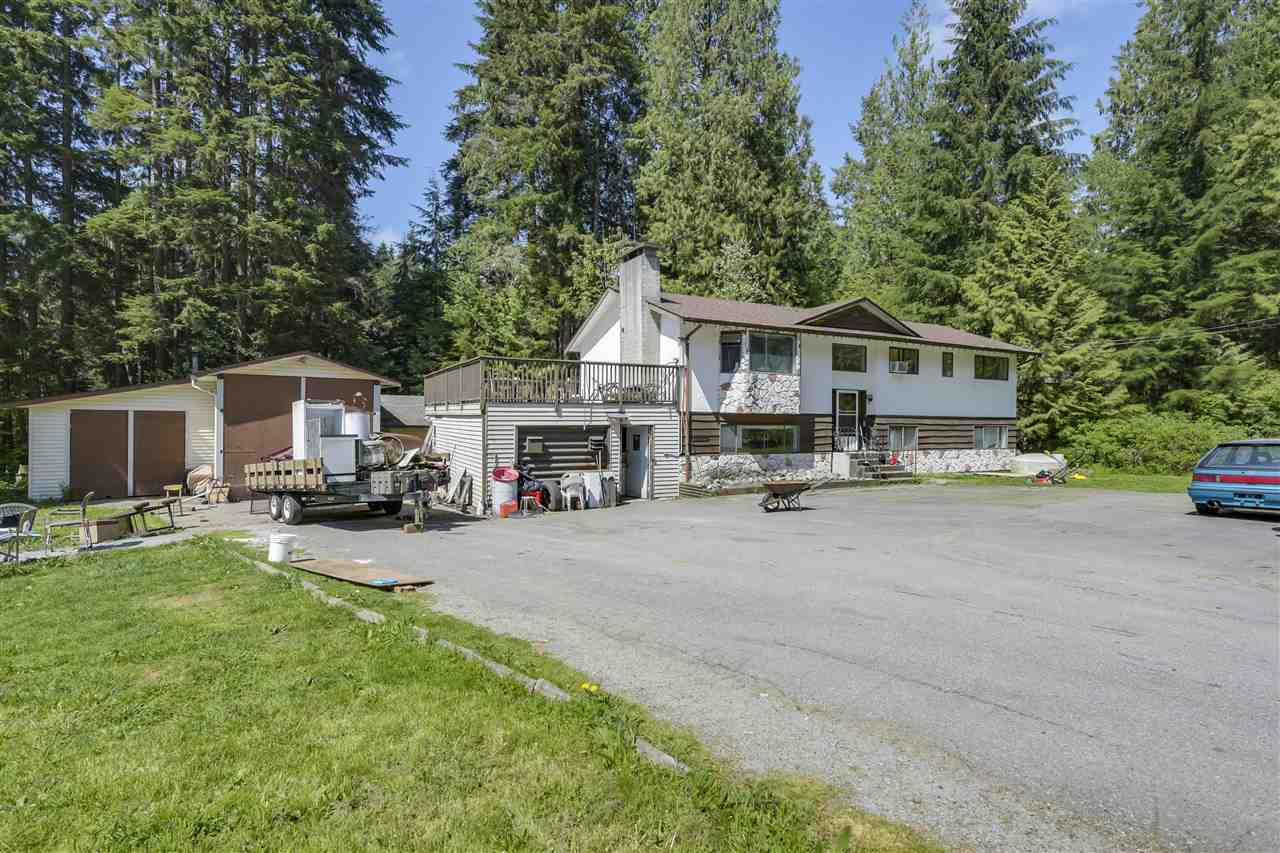 Almost 1/2 Acre lot backing onto Kanaka Creek Regional Park with a massive 800 sq ft shop and garage. This lot's massive 150 ft easy access frontage makes this property ideal for someone looking for a home based business that requires the shop and or equipment and located just a short distance from Dewdney Trunk Road. The large 2374 sq ft home is sound and sturdy but without a doubt requires updating and renovation. The roof however, 6 months new, and the home is very livable as is, water and septic system serviced and all in good order. Has high efficiency furnace with air conditioning. This home has served it's residents well for decades but it is time for new hands to care for this home.
