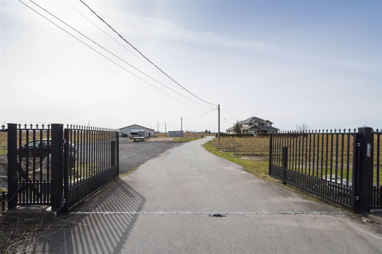 Future development. A rare opportunity to own a 24.75 Acres beautiful land just step away from Tsawwassen Mills and Tsawwassen Commons Shopping Centre. Full production Blueberry with custom built home 3,300 sq ft with detached barn.