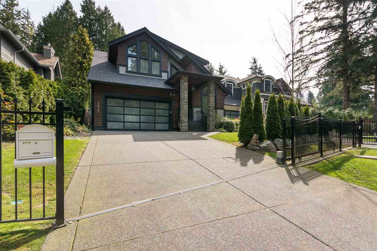 Your search is Over! Spectacular Metal Gated Estate Situated in one of the Ocean Park neighborhoods in South Surrey. This custom built residence was crafted by a local recognized Builder Mark IV Designs. No expense was spared on this impressive west coast contemporary two level home with a fully finished basement. Excellent open concept layout boasting double-height 20' ceilings in the main living areas. This home offers 4 large bedrooms upstairs, a top of the line kitchen, huge quartz counter tops, engineered hardwood floors, a home theatre, large two car garage with tons of storage space, and a private back yard. Convenient location, walking distance to shops, restaurants and to the water. Call to book a private viewing!