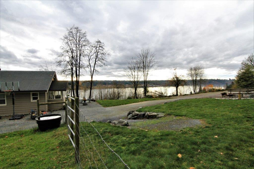 THORNHILL...... 3.26 ACRES WITH SWEEPING FRASER RIVER VIEW......  rancher  with unfinished basement awaitIng your ideas....the possibilities are many    Cute and cozy ranch-style home offering 2 bedrooms, metal roofing, NEW electrical and a GREAT view of Fraser River!  Live in or build your dream home.........and enjoy the quiet, country life of this rural area.....still within minutes of all amenities.  Fenced for animals.