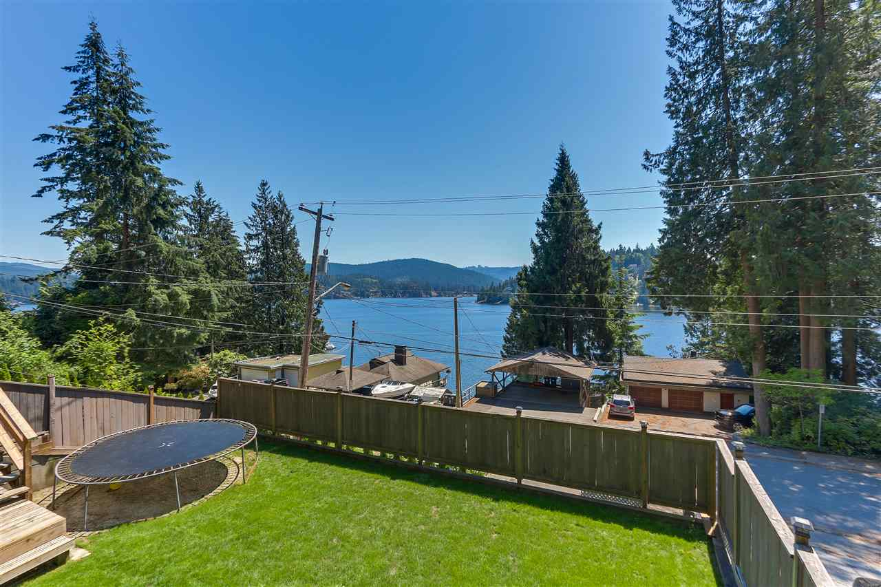 Semi-waterfront home in Deep Cove! Located on one of the most sought after streets, your family will feel at home with this beautiful, fully renovated 4 bedroom reverse floor plan home. Featuring stainless steel appliances in a chef's inspired kitchen overlooking views of the ocean and mountains. this home sits perched on a huge 30,000 sq. ft. lot with a sun drenched front balcony and a flat, fully fenced, grassy yard for the kids. Unwind on your back patio with a cozy gas fire pit or feel fit and active with your own private access to Quarry Rock! Seafood lovers will love fishing and crabbing just minutes from your door. Easily commute downtown in just 25 minutes or appreciate working from your home office outbuilding. Lots of parking available! Become a local of Deep Cove and enjoy life!