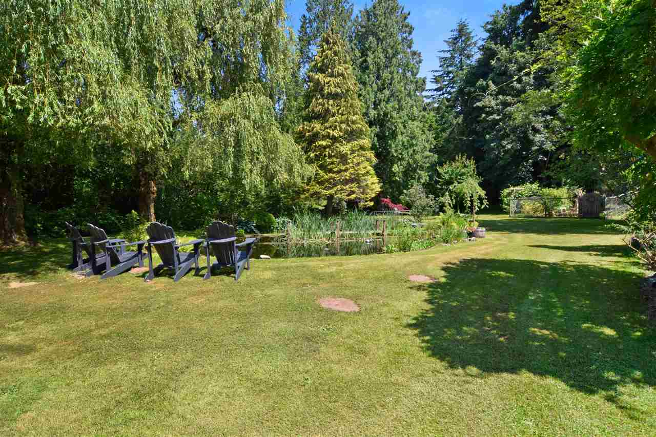 """SERENITY & PEACEFULNESS - this MAGICAL PROPERTY has it all.  Minutes to Shopping & Amenities. The Family Home is move-in ready with 2026 ft2 - 4 bed, 2 bath home (Reno 2010) with an unfinished basement, hot water on demand, water purifications system, automatic back-up generator, the list goes on and on. The all useable & STUNNING 1.77 acre property offers a 900 ft2 detached Workshop w/100 amp service, separate Landscape Garage, heated Art Studio, enclosed Vegetable Garden, and parking for over a dozen vehicles.  You couldn't ask for a nicer property to raise a family. """"Rural Oasis - minutes away to Urban Amenities?  Link for Drone Video: https://youtu.be/tCeDCi37tos"""
