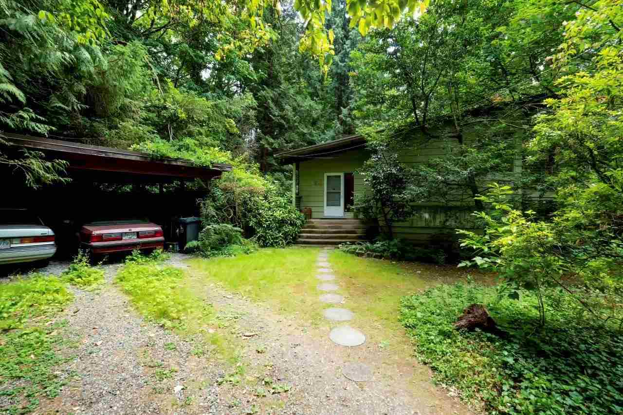 Value is mainly in the 132' x 125' property in ideal location.  Close to 2nd Narrows Bridge but extremely quiet.  Maplewood town center only a short stroll away.  RS3 zoning will allow for 2 lots.  OCP RES 2.  Vintage post and beam is livable if you want to hold and build later.  This lot offers total privacy, is directly across from the Seymour River and gets great sun.