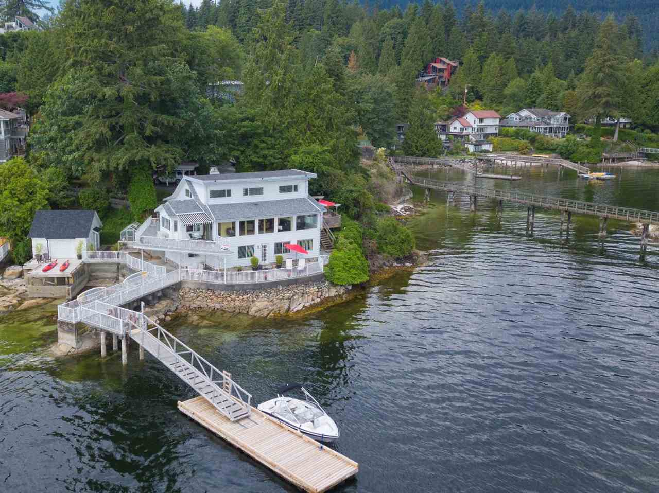 This spectacular waterfront oasis offers a peaceful and serene setting! Rarely do homes like this come on the market - with over 114' feet of waterfront  - your own private dock, a free-standing Boathouse and Beach access - ideal for kayaking, paddleboarding, swimming, and boating. This lovingly cared for family home has been well maintained and updated through the years, it's hard to find another home  situated this close to the water which makes this extra special. Offering 4042 square feet; with 5 bedrooms, 5 bathrooms, gas fireplace, large windows all embracing the water views. Private wrap around patios and decks too. An overall gorgeous 11,500 square foot property, with garden sheds, terraced lawns, lovely gardens and mature trees. Call today to view this irreplaceable property!