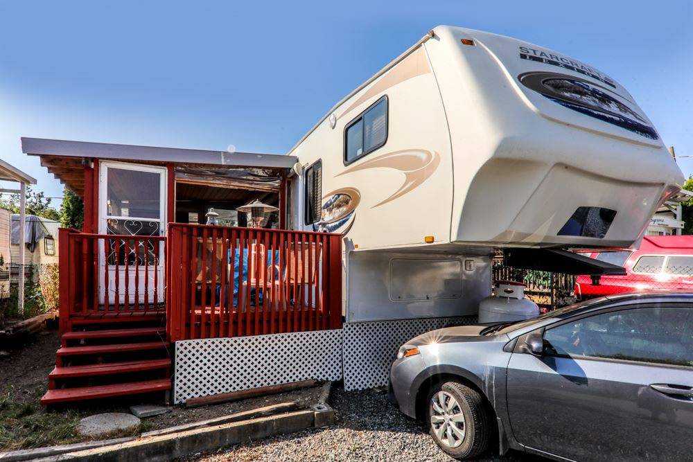 RV lot and large 2011 Lexion Lite 31 BSSA Starcraft fifth wheel with covered deck and shed with washer dryer, steps to Hatzic Lake. Fully serviced lot in best part of the area. Swimming, fishing, boating, amenities include huge rec centre with big screen TV & pool table, childrens playground, boat launch, boat store, washrooms, horseshoe pits and covered picnic tables throughout complex. Amazing recreational facility for summer fun with family or for retirees. Annual taxes include maintenance fees. Well worth the short hour drive from Vancouver or 30 minutes from Maple to make family time and memories.