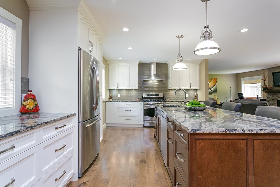 Beautifully renovated 4 bed/3 bath home w/ well-designed layout on oversized private meticulously manicured lot backing onto greenspace. Large 2008 addition seamlessly integrated into open concept main floor featuring newly renovated kitchen w/ high-end finishes, solid wood custom cabinetry & Cambria quartz counters, large walk-in pantry, gas fireplaces in family & living rooms & new engineered wood flooring. Three spacious bedrooms upstairs incl stunning master suite w/ 5 piece ensuite, WIC, sitting area, fireplace & balcony. Extremely private parklike backyard is fully fenced & offers a large flat area for the kids/pets, huge deck & storage shed. Nothing to do but move in and enjoy. Across from Seymour River & steps to biking/hiking trails.