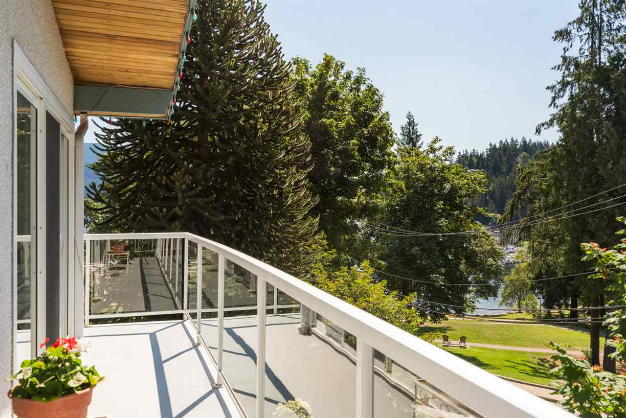 Amazing location with nothing but park and ocean in front of you! This wonderfully bright, semi-waterfront home sits just steps from the beach and a short walk to the cafes and shops of Deep Cove Village, the marina and the Quarry Rock trail. A sun-drenched SE-facing 350 sq ft wrap-around deck is perfect for summer dinners outside with friends and family, or just relaxing with a book in privacy. Expansive windows surround the living and dining area, filling the space with light. Functional layout with 3 good-sized bedrooms upstairs (master with ensuite). Fully developed on ground floor with an additional 2 bedrooms. This home has SO MUCH potential, esp. for those with an eye for design.New hot water tank, high efficiency furnace and replaced windows are a bonus. Lots of storage space for those with a penchant for paddle boarding, kayaking or biking. Amazing opportunity to livewith the ocean just steps from your door, mountains surrounding you and downtown Vancouver 30m away. Priced below assessed value.