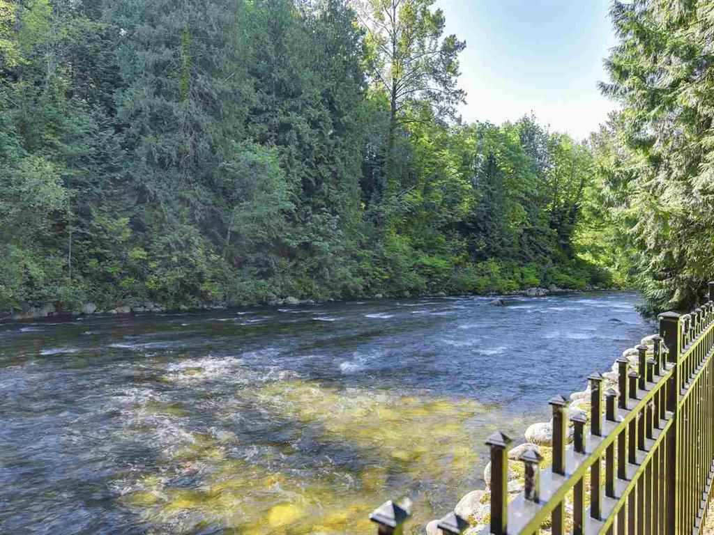 RIVERFRONT property right in the City, truly a rare find: This beautifully renovated cottage home is on a SUNNY 99' x 130' FLAT lot backing right onto Seymour River. Enjoy the peaceful, serene, and whimsical setting that this UNIQUE property has to offer. The proud owners have tastefully RENOVATED to provide modern comforts, but kept the original CHARM, like the giant double-sided river rock fireplace, tongue and grove hardwood flooring, solid fir doors, oversized cedar beams and exposed rafters. Enjoy the outdoors and the soothing melody of Seymour River all year round from the two large covered patios. No houses on the other side, so it is very PRIVATE. Nested in the nature, yet minutes away from transit, shopping, and downtown.