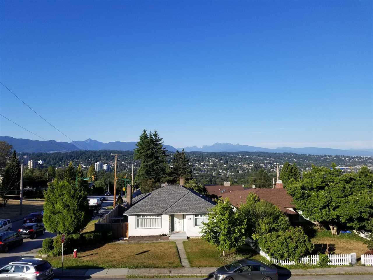 """The Heights"". Beautiful North East Views, Mountain and Fraser River Views and Enjoy Mount Baker on a clear day. Home sits High side of the street. 2 Levels, 3 Bedrooms, 2 Laundries. Upper Level, Nice Hardwood Floors up with some updates, Kitchen was remodeled 2013. Some Double Glazed Windows. Roof was done in 2014. The Hot Water tank 2015, Furnace approx 2013. Double Carport off Rear Lane. Across from park, great for kids play. Walking distance to the Crest Plaza Shopping and Bus Transit, Close to Canada Games Pool. School Catchments, F W Howay Elementary School, Ecole Glenbrook Middle & New Westminster Secondary, Close to Douglas College and SFUniversity. Perfect Starter Home, or rent out and make a great investment. Close to Lougheed Mall, Korean Hannam Supermarket, Quay and Skytrain."