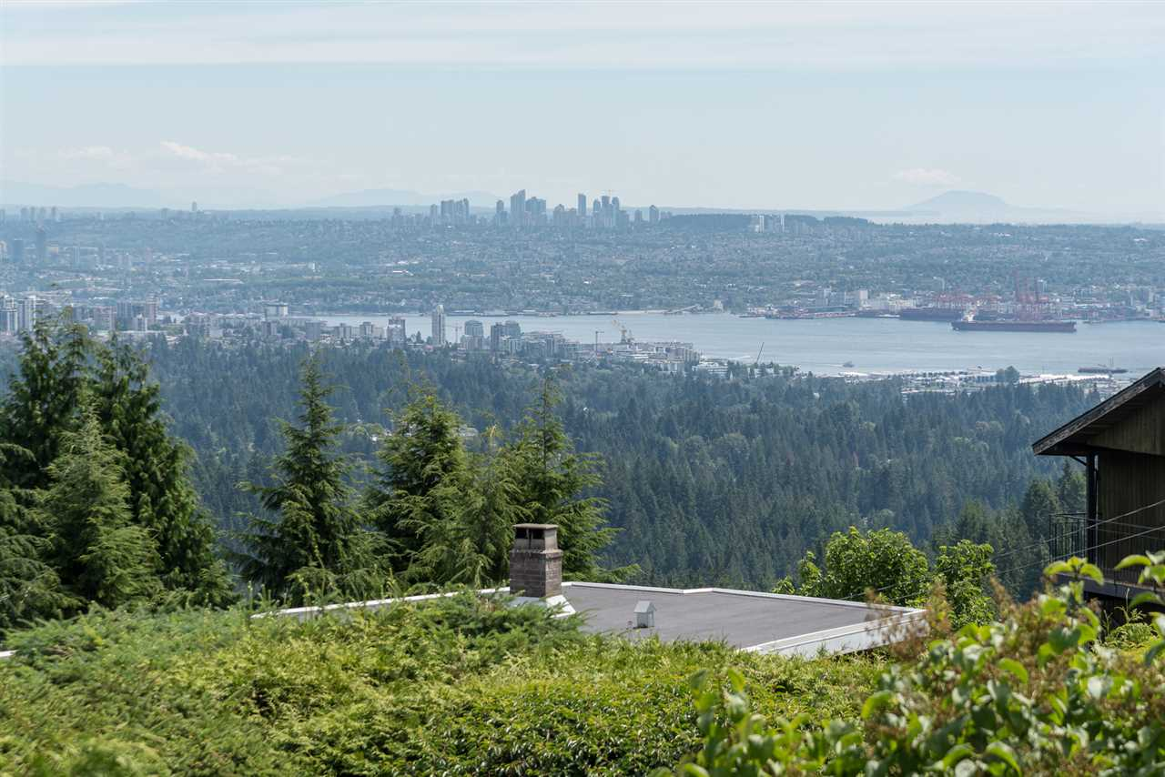 Immaculately maintained original home on a 16,524 sq. ft sloping lot, featuring impressive VIEWS of Vancouver?s harbor, Mount Baker and Grouse Mountain. This 3 bm home was cleverly built in reverse plan to take advantage of the VIEWS  There are 3 bedrooms down with 2 baths and another ½ bath up for the upper level. A large spacious family room adjacent to the living area is perfect for big family get togethers.  The upper deck spans the entire back of the home providing a gorgeous very private outlook of mountains, water and city.  The property has been meticulously cared for with many beautiful shrubs and trees.  This is a happy home, with EXCELLENT VALUE  in the LAND and a great build-able future in an area where many new luxury homes are currently being built .  Great schools too! Collingwood, Westcott & Sentinel Secondary & Mulgrave are all close.